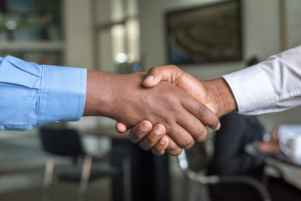 Shaking hands in offer of congratulations.