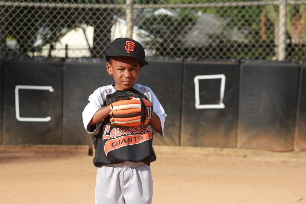 Young softball player getting ready to catch.